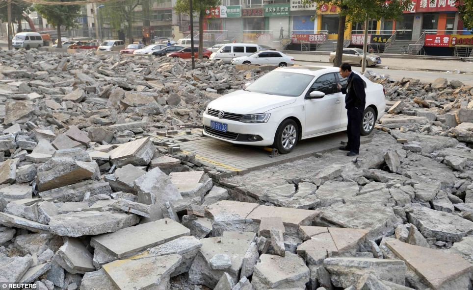 Car Park Demolished Around Car - China News - VW advert