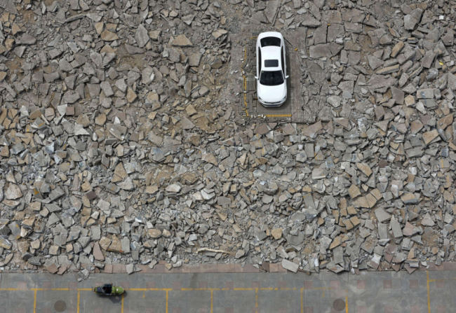 Car Park Demolished Around Car - China News - aerial