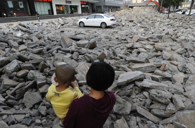 Car Park Demolished Around Car - China News - ground