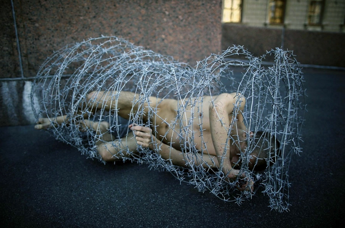 Russian Artist Wrapped In Barbed Wire - Art Shot