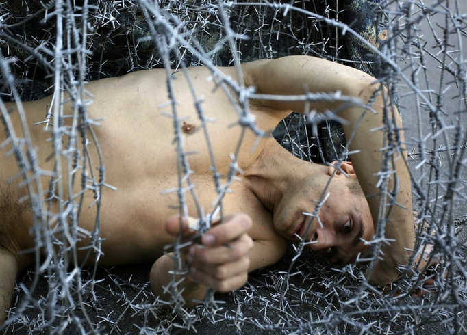 Russian Artist Wrapped In Barbed Wire - Close Up