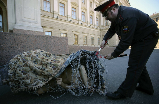 Russian Artist Wrapped In Barbed Wire - Cut Out