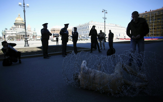 Russian Artist Wrapped In Barbed Wire - In Street