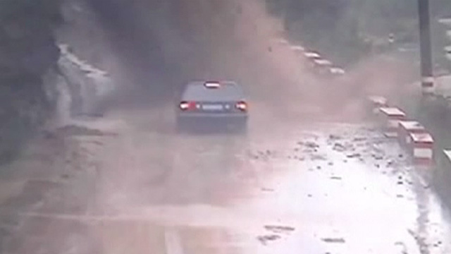 Landslide engulfs car in China