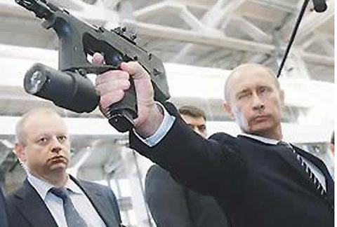 Putin Looking Like Hero James Bond - Gun Close Up