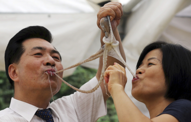 South Korea - Food Festival - Eating Live Octopus - Couple