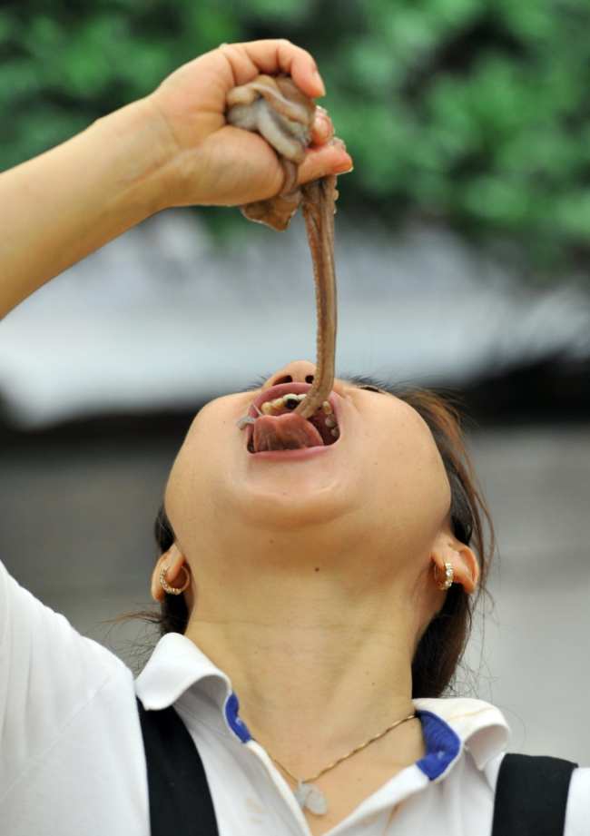 South Korea - Food Festival - Eating Live Octopus - Lady